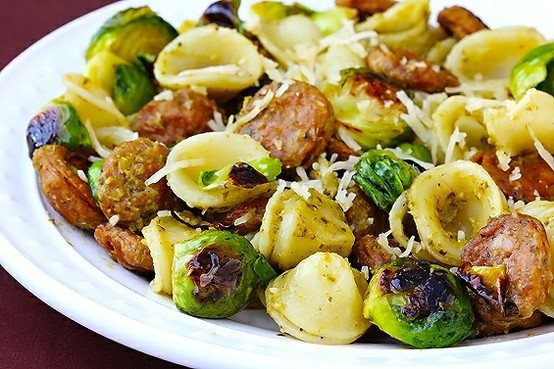 Pesto pasta with chicken sausage & roasted brussels sprouts. My stomach is rumbling.
