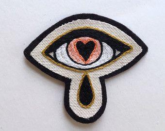https://www.etsy.com/es/listing/476330901/parche-ojo-heartsick-habia-bordada-a?ref=shop_home_active_6