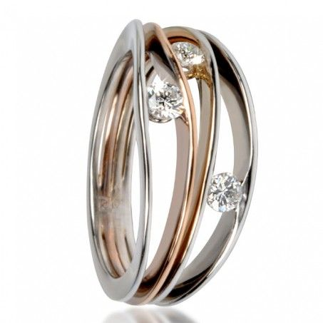DAISY: A young and modern diamond ring to be worn at all times. Consisted of 4 rings in one or two colors 18 carats gold interwined, in an elegant movement 3 diamonds DEF / LC-VVS of 0.10 carat each.