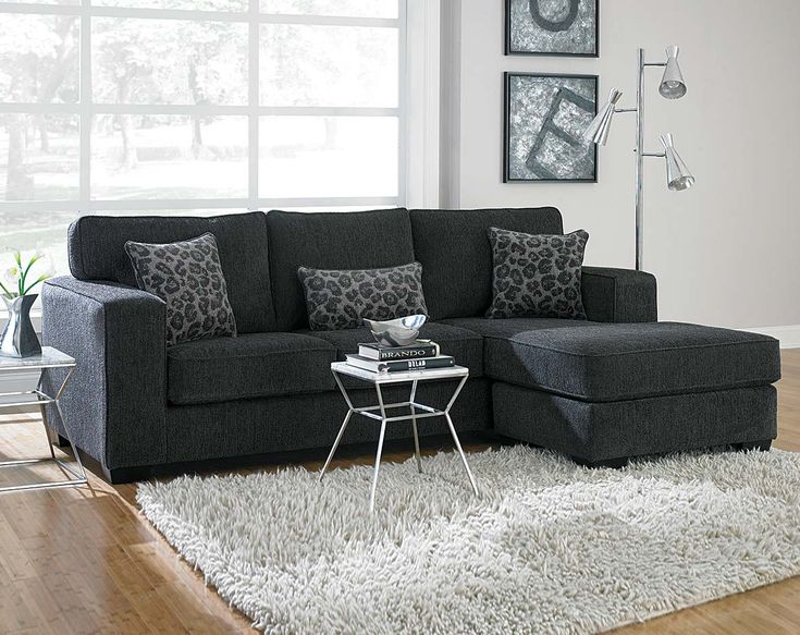 This Dark Gray Sectional Sofa Is Covered In A Soft Chenille And Has Leopard Print Accent