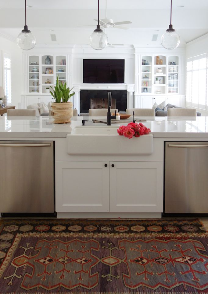 Before and After: Olympic Way Project. White cabinets, lights, faucet, black hardware.
