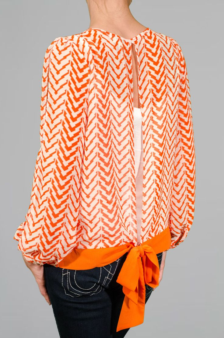 Orange Chevron Blouse    http://www.lmaeboutique.com/orange-chevron-blouse.html?custom_ref=pRN2CP    $28    Nice back view. Why not use this slit back over dedicated tanks and teashirt/blouse combinations.