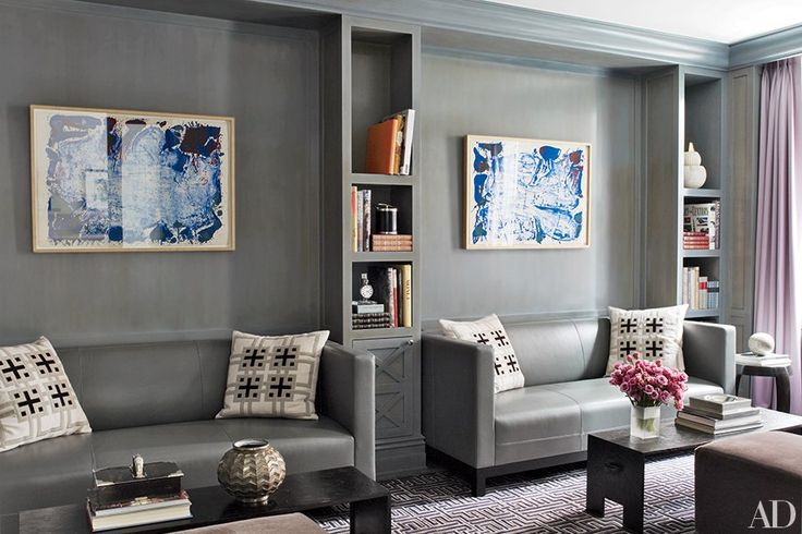 """""""Gray can fill a room with atmosphere—making it comfortable and inviting yet striking and sophisticated. I love an elusive, ever-changing shade, which you can play up by buffing and shining the walls to capture the luminescence.""""  The library of a prewar Manhattan apartment by Penny Drue Baird includes niches to hold matching custom-made sofas upholstered in a Holly Hunt leather; the walls are painted in a dusky gray."""