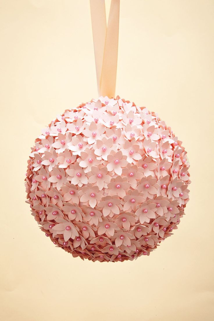Create this pretty pomander using flower-shaped cuttings and a styrofoam ball