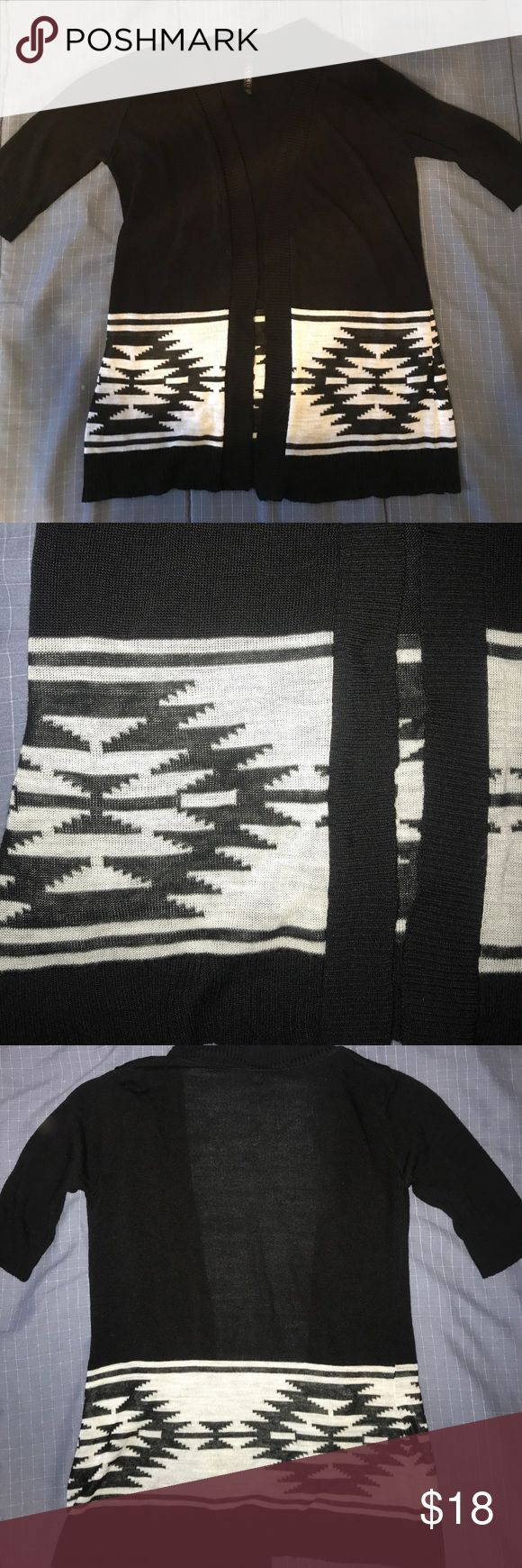 Absolutely Aztec print cardigan Absolutely Aztec print cardigan. Black and white open front cardigan. Longer short sleeved. A little above elbow. Colors may vary slightly from pictures. Absolutely Creative Worldwide Sweaters Cardigans