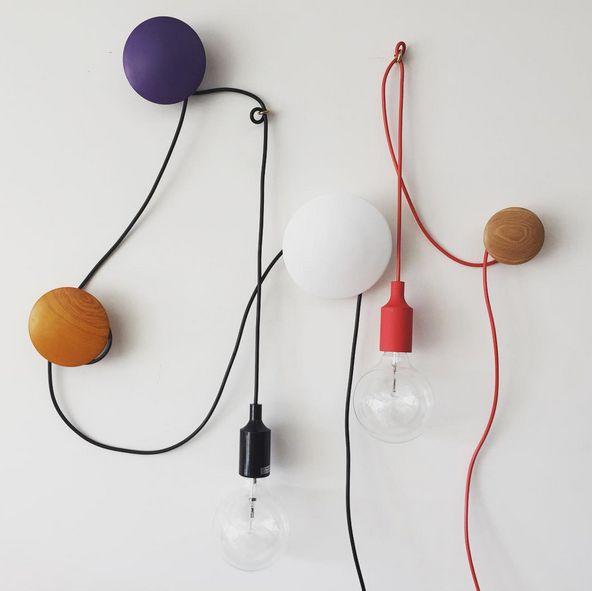 Creative showroom moment using a mixture of our Replica Muuto Dots and our Replica Mattias Stahlbom E27 Pendant