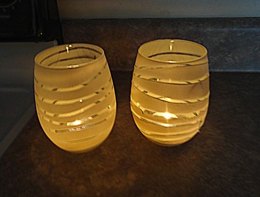 DIY candle holders using rubber bands and spray paint