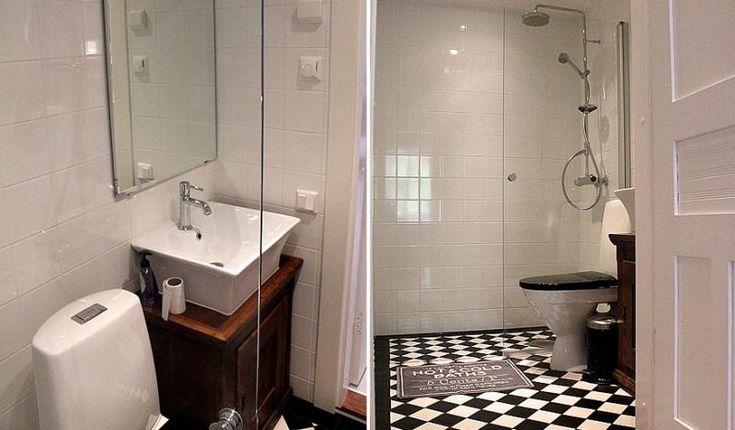Kylpyhuone on mustavalkoinen. C-asunto