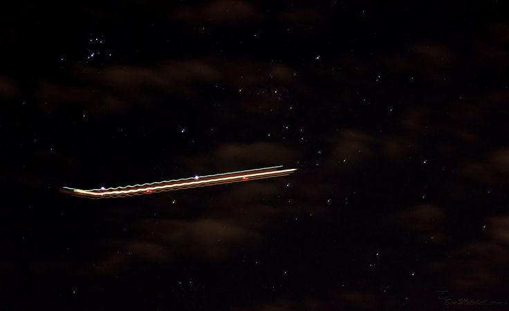 L1M2AS3 - Blurred Motion - Canon 550D, TV mode, no flash, tripod, f5.6, 3.2sec, iso2000(auto), 96mm, awb. Tried something a bit different with this one.... The light trails of a plane flying through the night sky with a galaxy of stars as a backdrop. Feedback most welcome