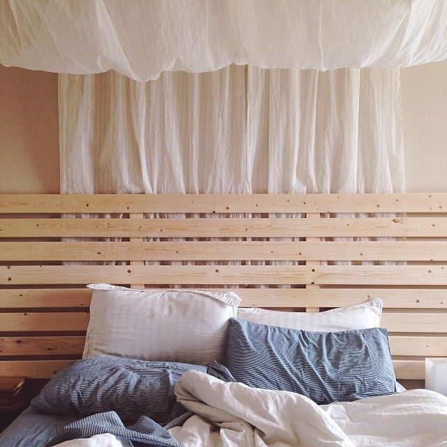 So in love with our homemade bed frame and DIY canopy! Messy bed sheets and all, it's such a rejuvenating little corner and our favorite place to relax. At the end of a long day, nothing beats curling up with a good book, hot chocolate chip cookies, and the dogs cuddling at our feet.