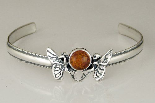 Wonderful Pair of Fairies on a Cuff Bracelet Accented with Genuine Amber The Silver Dragon- Bracelets. $75.00. This Bracelet was Designed by The Silver Dragon, a Jewelry Shop in New England. Thank you for Supporting American Business.. This Bracelet Fits a Standard Woman's Wrist. This Unique Bracelet is Created only after Your Order Arrives. Please Allow 7-10 days for Delivery.. The Silver Dragon uses Sterling Silver that has been Reclaimed... Helping Save Mother Earth's...