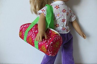 Dolly Duffel Bag tutorial!  This one starts with a tote bag and cuts it apart, but you can just purchase fabric and the handle's by the yard.  complete illustrated DIY how-to in link.