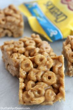 Peanut Butter Cheerio Bars- Just three simple ingredients wit no baking involved. Perfect for school lunches or snacks.
