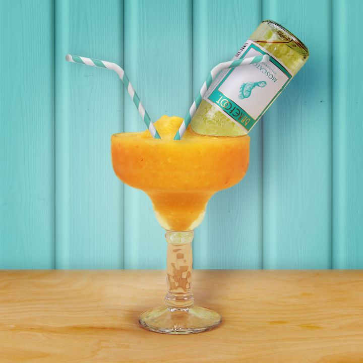In a blender, combine Tequila, peaches and Margarita mix and blend well. Pour into your favorite glass, then tip a Mini Barefoot Moscato in, and enjoy!