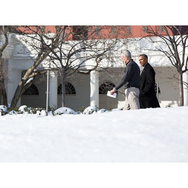 President Obama walks along the South Drive of the White House with Chief of Staff Denis McDonough.