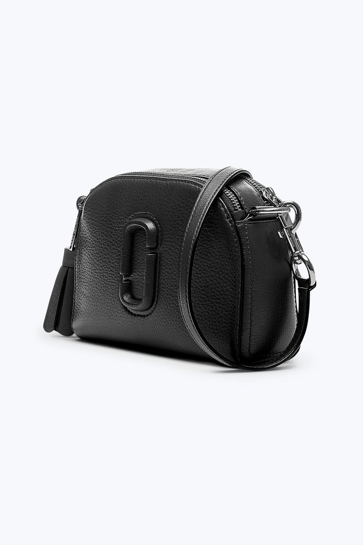 This camera bag prefers to have its picture taken. Take everything you need (and the things you just want) in this structured, understated dual compartment bag that makes any look photo-ready with subtle leather Double J logo on exterior.