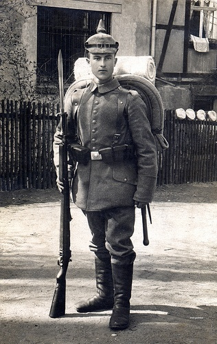 Imperial German Army -  Symmetric 8 button tunic with no breast pockets. Classic Dunkelblau helmet. WWI.