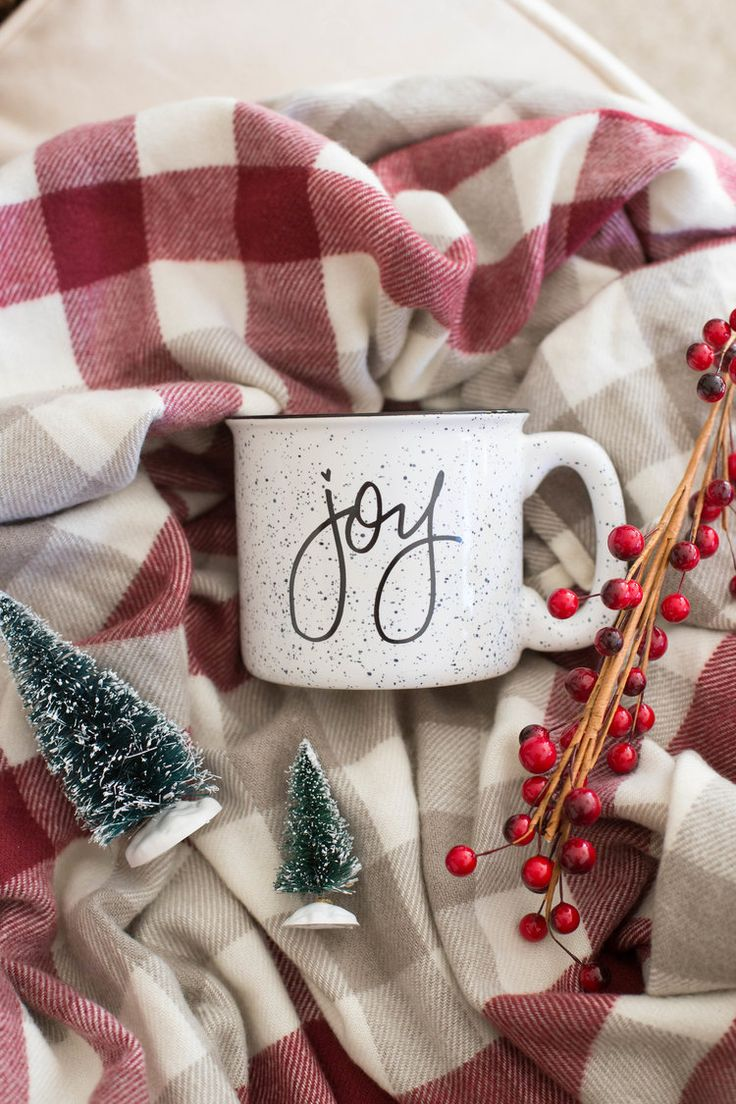 """""""Joy"""" White Ceramic camper mug.This hand lettered ceramic camper mug is part of the Rachel Allene Christmas collection! These mugs are the PERFECT gift for your gal pal, or your special someone. This is 11 ounce ceramic mug is dishwasher and microwave safe."""