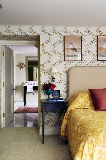 This bedroom is particularly sumptuous, with its floral Braquenié wallpaper.