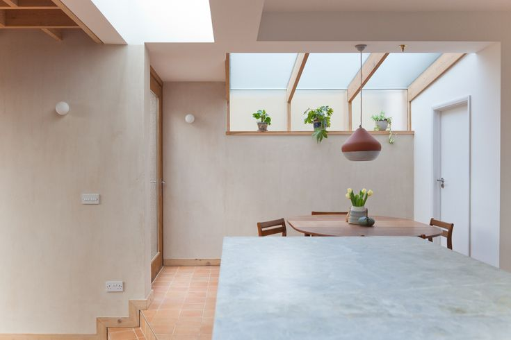An Italian marble with veins of rust running through a grey/ white background was chosen for the kitchen worktops and island picking up the earthy tones of the walls and floors.
