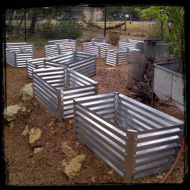 corrugated garden beds ready for planting