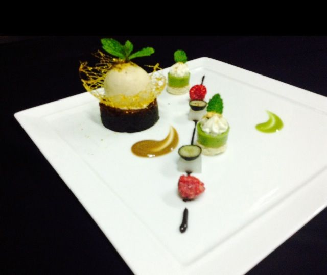Dark Chocolate Tart,Hazelnut Ice Cream in Caramel Nets & Pistachio Dacquoise