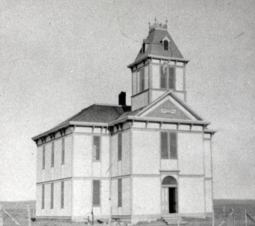 Two Story School House With Bell Tower At