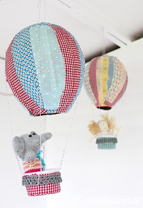 How to make: paper mache hot air balloons covered in fabric scraps (perfect for a nursery/ baby shower or play room)