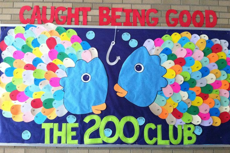 CAUGHT BEING GOOD! Rainbow Fish positive behavior bulletin board. We are using these in our school-wide positive behavior interventions and supports (PBIS) program as part of our 200 Club incentives. I finally finished them! The scales are made from card stock. I folded each piece in half twice and cut the scale shape so they would be roughly the same size and we could attach the Positive Paw Tickets right  to the scales.