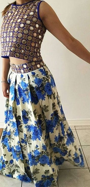 Love the fact that the skirt waistband and blouse are the same contrasting pattern and colour to the skirt.