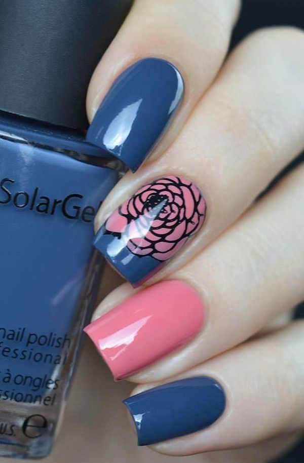 Pink and Blue Floral Nail Art. This girly girl floral nail art can go with your short dresses as well as with your jeans. Try it out!