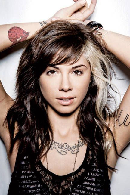 Christina Perri. Amazing singer her songs are full of passion and her tattos are unique and awesome!