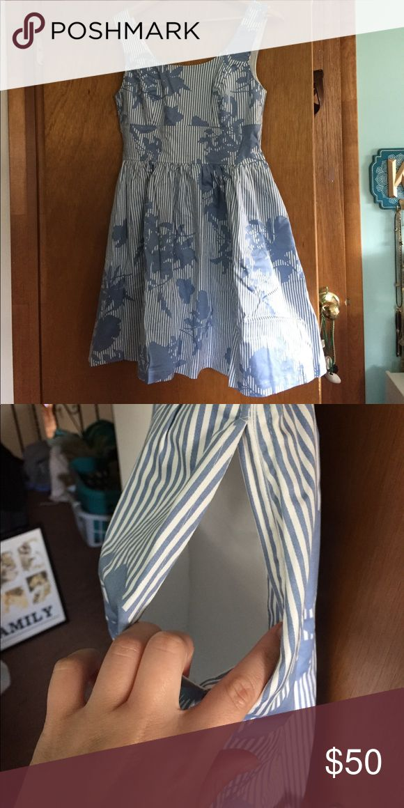 Eshakti Light blue floral striped dress. NWOT Perfect for summer or a tea party. Light blue and white dress with vertical stripes for the perfect slimming look and floral pattern. Above the knee. Pockets in seem as shown in pics.BRAND NEW NEVER WORN eshakti Dresses