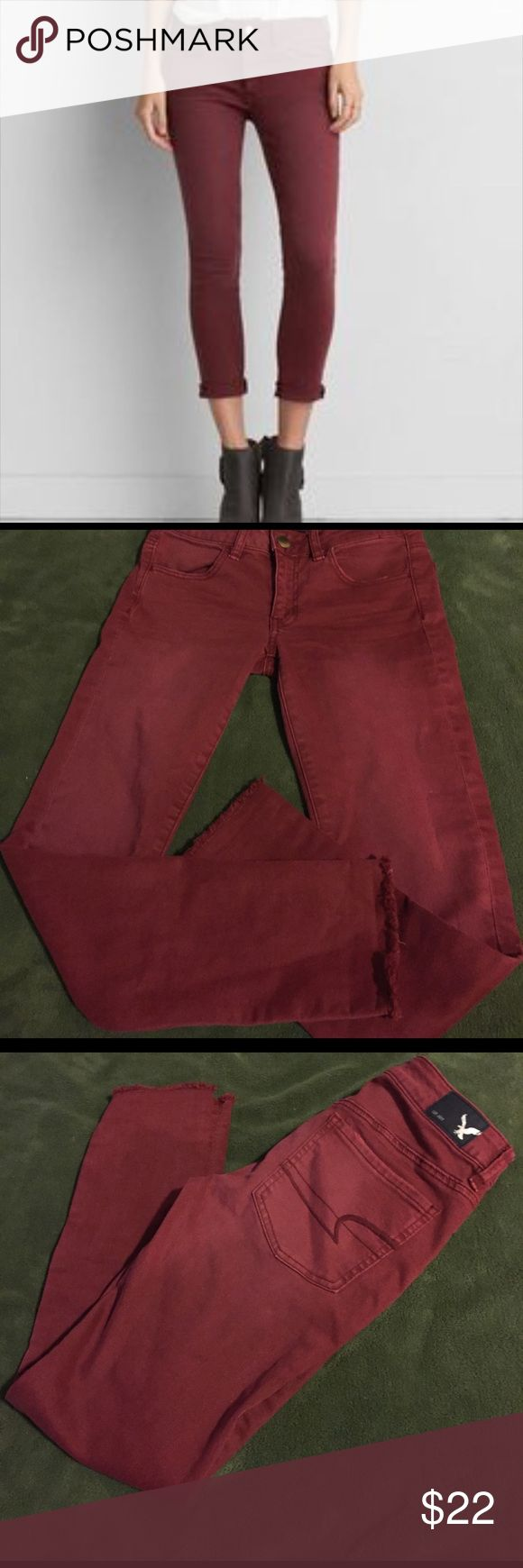 American Eagle jegging crop jeans These are a burgundy color pair of jeggings from American Eagle in the fit jegging crop.. the stock photo has the hens rolled, these are raw edge bottoms but can be rolled also.. great condition American Eagle Outfitters Jeans Ankle & Cropped
