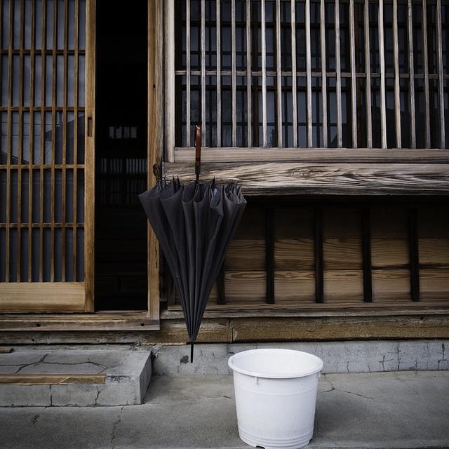 drying umbrella, urayasu http://www.lucidcommunication.com/2012/05/05/the-urban-life-side-of-urayasu/