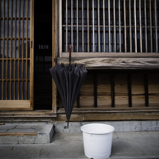 drying umbrella, urayasu http://www.lucidcommunication.com/2012/05/05/the-urban-life-side-of-urayasu/