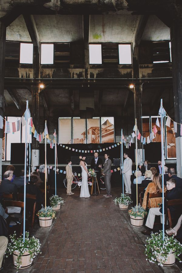 Prettify a warehouse location with plants & bunting sticks #wedding