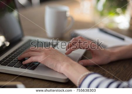 Woman's hands on the keyboard of laptop. Distance learning or work from home.