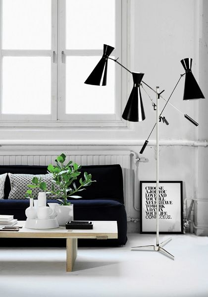 Stanley standing lamp has a unique sculptural shape. This vintage lamp's structure is handmade in brass and the lampshades in aluminium. It's a versatile lamp which gives a sophisticated and classy ambiance to any living room or bedroom. A style icon of the fifties and sixties.