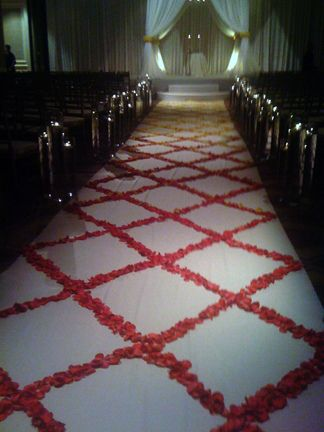 Lattice patterned rose petal aisle starting with yellow and turns to pink.