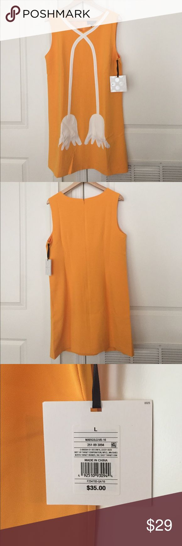 Victoria Beckham for Target NWT. Victoria Beckham for Target size Large. Very nice dress in yellow orange color with white flower design. Looks elegant and comfy in any occasion. You can wear it with a blazer and nice shoes for formal wear and as is with white sneakers for a casual wear! Victoria Beckham for Target Dresses