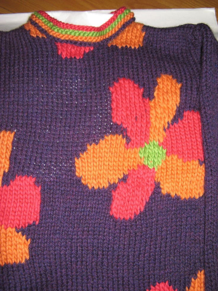 Flower Power sweater - colorful pedals pop against this dark rich purple.