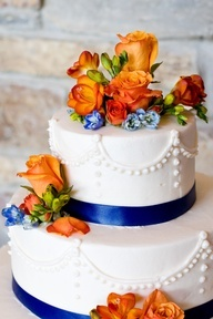 wedding cake with blue scroll and orange flowers - Google Search