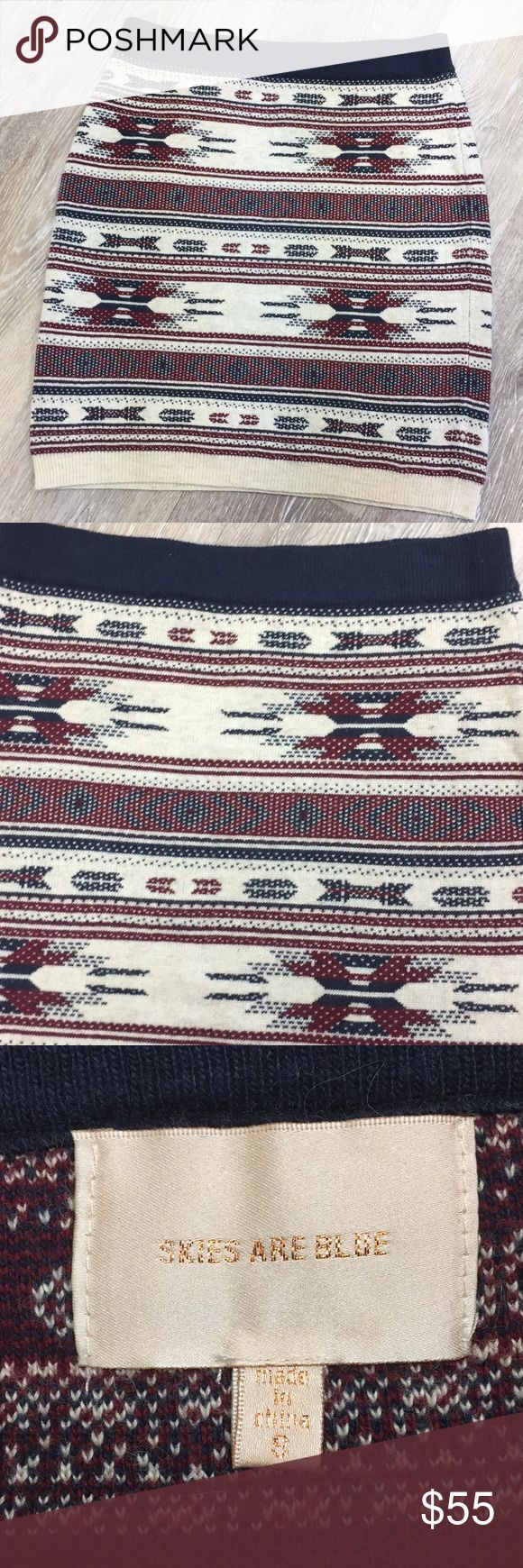 Skies are Blue - navy and wine Sweater Skirt Size Small sweater skirt. Navy blue and wine colored print. By skies are blue. Never worn.   💋Please ask any questions you may have BEFORE purchase.💋  ❤️ Bundle together with other items for the cutest outfit, and best deal!! ❤️  😍 I am ALWAYS open to offers, please just submit your offer with the offer button!!! 😍  🎀As always HAPPY POSHING. 🎀 Skies Are Blue Skirts Mini