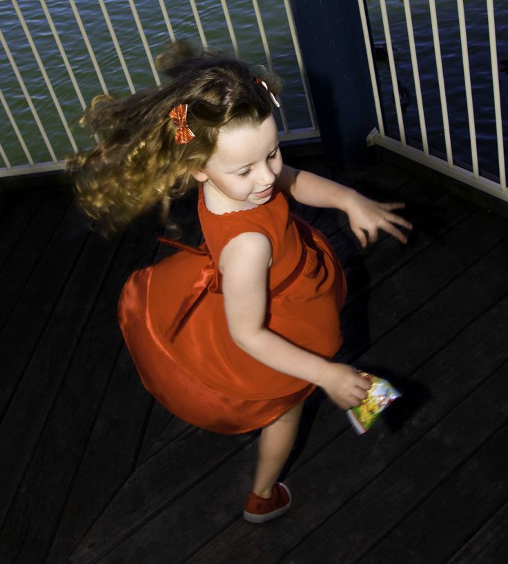 Kate -Sleeveless Elgant red dress with lace trim details with satin corsage and belt at the waist. www.elfinkidz.com