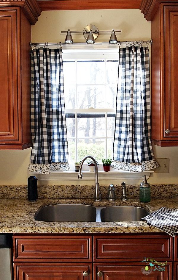 Frugal decorating - found some long panels at the thrift store and reworked them into curtains for a kitchen window