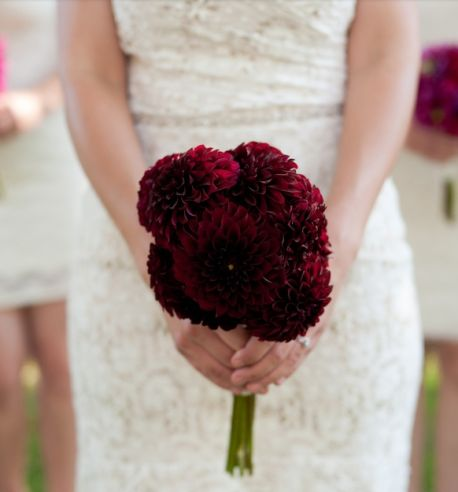 Loving the contrast in colour of the burgundy dahlia bouquet & the wedding dress
