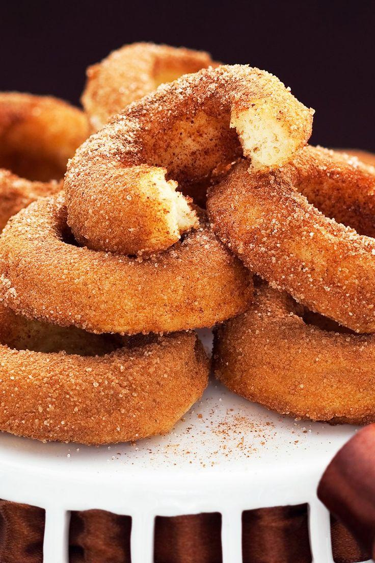 Cinnamon Sugar Baked Doughnuts Recipe - delicious cake doughnuts dipped in butter, then rolled in cinnamon sugar.