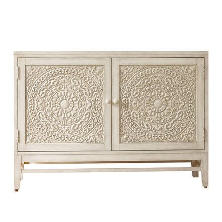 Perfect for stowing table linens in the dining room or everyday essentials in your entryway, this 2-door cabinet offers elegant style with carved medallion-i...