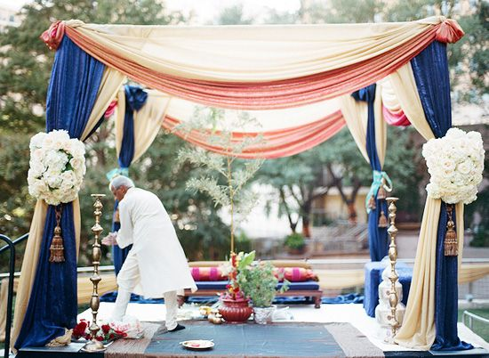 Simplistic mandap made pretty just by colorful cloth. Great idea for day wedding.